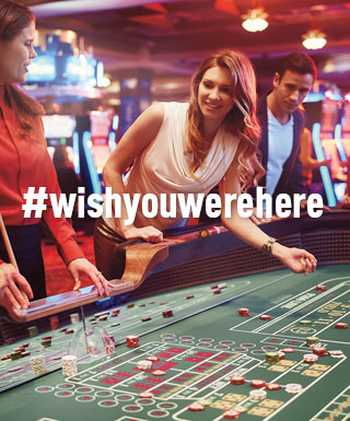 "woman throwing dice at craps table with text ""#WishYouWereHere"""